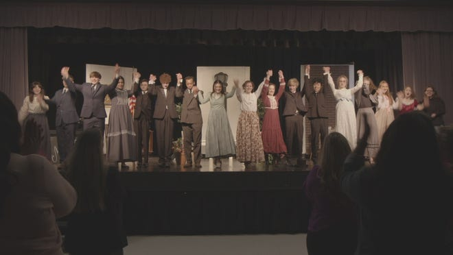 "In the finale of ""The Story of Mother's Day,"" local high school actors take a curtain call after performing in a school play."