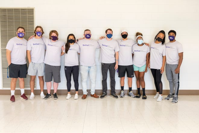 Bethel University sports management students smile under their masks before heading to Cleveland for the NFL Draft earlier this week.