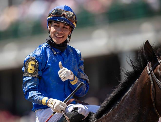 Jockey Jose Ortiz celebrates after winning the Grade II Alysheba Stakes aboard Maxfield at Churchill Downs. April 30, 2021