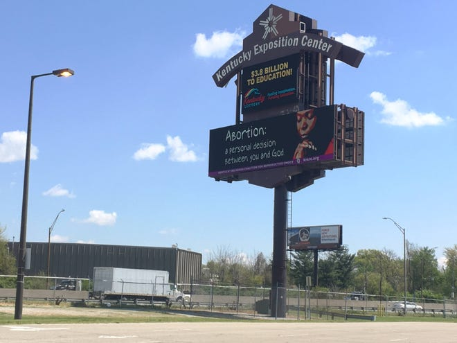 The Kentucky Religious Coalition for Reproductive Choice says its message was removed from a Louisville billboard near Interstate 65.