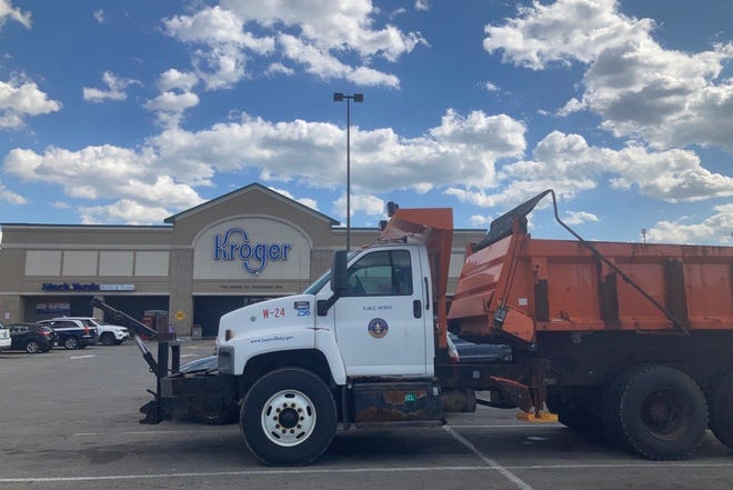 Five public works trucks were stationed in Kroger's parking lot at 28th Street and West Broadway April 30.