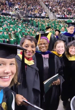 Frances Kaneene (center) with students and colleagues at Michigan State University's graduation ceremony in December 2019.
