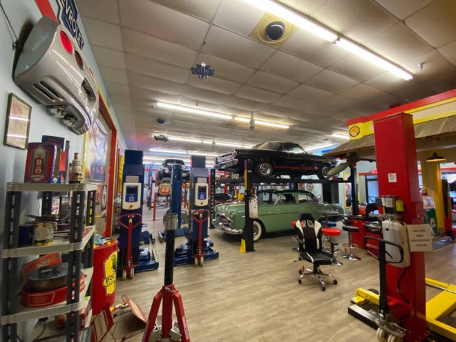 The Lift SuperStore showroom provides inspiration to fix up garages, with such displays as a green 1952 Packard 200 Deluxe with whitewall tires.