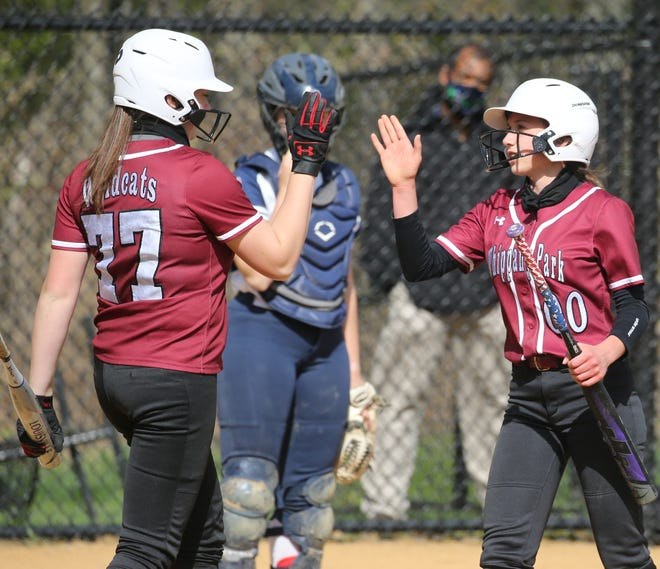 Julia Swan greets Mikayla Swan of Whippany Park after Mikayla scored the first run of the game in the first inning as Whippany Park played Randolph in Girls Softball on April 30, 2021.