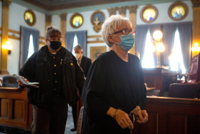 Victoria Corson, 72, is handcuffed and escorted out of Judge Thomas Marcelain court room at the Licking County Common Pleas Court after being sentenced and changing her plea to a guilty plea for the 2018 murder of her longtime boyfriend Frederick DeVito in Newark, Ohio on April 30, 2021.