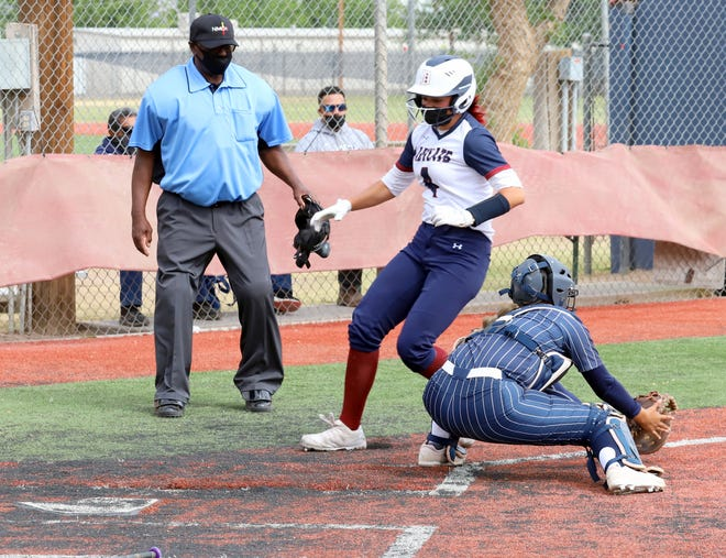 Lady 'Cat Jocelyn Aguayo (4) beats the throw home to score a Deming High run during Thursday's double-header sweep by the Silver High Fighting Colts.