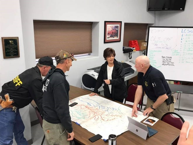 U.S. Rep. Yvette Herrell (R-NM) (center) speaks with Lincoln County officials about the Three Rivers Fire, April 29, 2021.