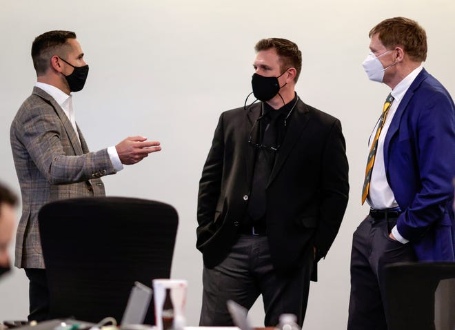 Head coach Matt LaFleur, from left, general manager Brian Gutekunst and team president Mark Murphy gather in the Green Bay Packers' draft room at Lambeau Field on Thursday, April 29, 2021.