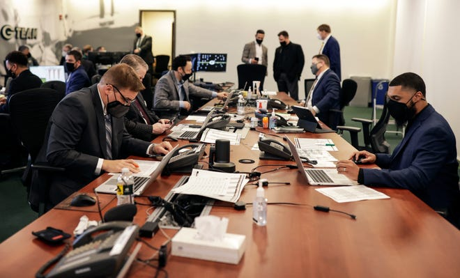 Scouts work inside the Green Bay Packers draft room at Lambeau Field on Thursday, April 29, 2021.