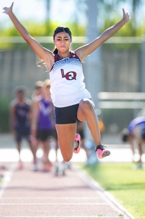 Shadow Hills and La Quinta track and field athletes compete in the long jump during the meet in Indio, Calif., on April 29, 2021.