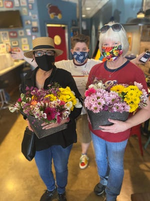 Lara and Elayne White of Periodyc Baker and Cherry Dellios of Wild Thing Botanicals volunteer with The Joy Bus to bring comfort and friendship to cancer patients.