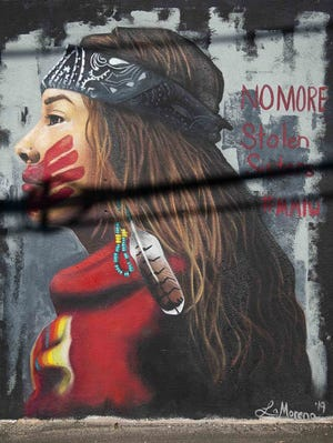 A Missing and Murdered Indigenous Women mural by artist Lucinda Yrene is seen in April at the Churchill in Phoenix.