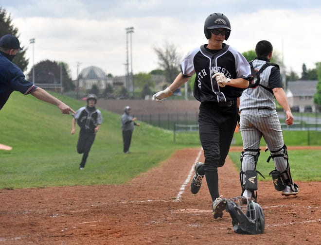 From right, York Suburban's Collin Boldt looks for the ball as South Western's Landen Eyster scores a run during baseball action at York Suburban Senior High School in Spring Garden Township, Thursday, April 29, 2021. South Western would win the game 8-2. Dawn J. Sagert photo