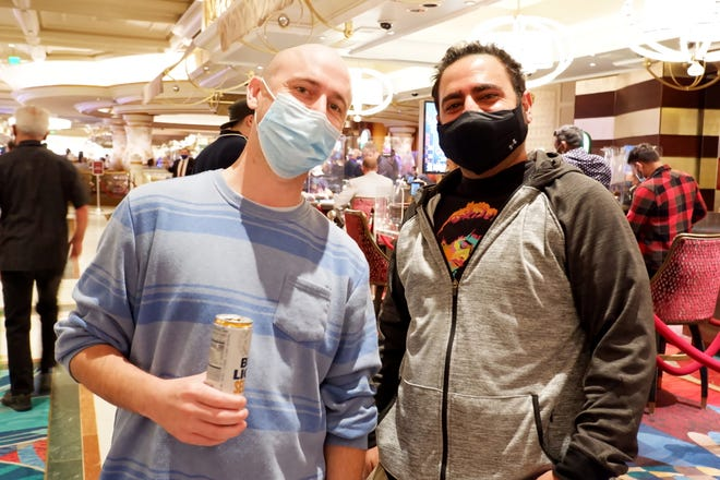 Daniel Erskine, left, did not get the COVID-19 vaccine, but he said that wasn't going to stop him from visiting Las Vegas.