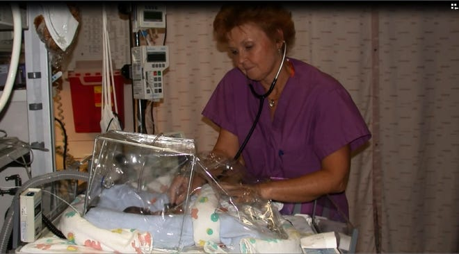 In this undated photo, Dr. Melinda Slack tends to a preemie in Mercy's NICU. Slack retired this month.