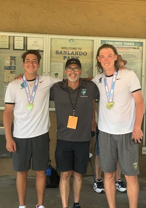 Jensen Beach juniors Gabriel Escobar and Nicolas Galligan with Falcon head coach Mark Conrad celebrate after the duo won the 2A doubles state championship, prevailing in a third set super tiebreaker 11-9 overPine Crest seniorsJameson Corsillo and Andrew Pereverzev at Sanlando Park in Altamonte Springs on Friday, April 30, 2021. The final scores were 7-6 (4), 0-6, 11-9.
