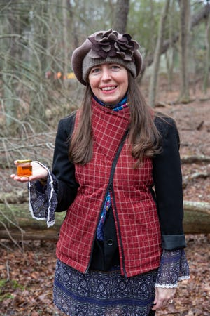 Judy Vogel, professor, Stockton University, with a sample from the first batch of New Jersey Maple Syrup produced by the university's Maple Grant Team.