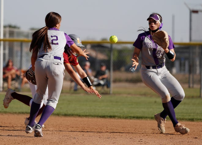 Mission Oak's Rebekah Beasley flips to Payton Quinonez for a double play against Tulare Union during their softball game in Tulare, Calif. Thursday, April 29, 2021.