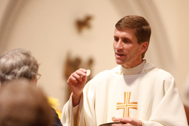 Monsignor William Koenig gives Communion during a 2009 Mass at St. Agnes Cathedral in Rockville Centre, New York.   Pope Francis appointed Koenig as bishop of the Diocese of Wilmington.