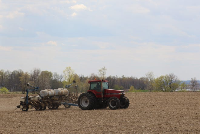 A farmer heads out to plant corn in the town of Leroy in Dodge County. Farmers across the state are enjoying favorable planting conditions,  this spring. Currently half of Wisconsin's corn crop is in the ground thanks to dry weather.