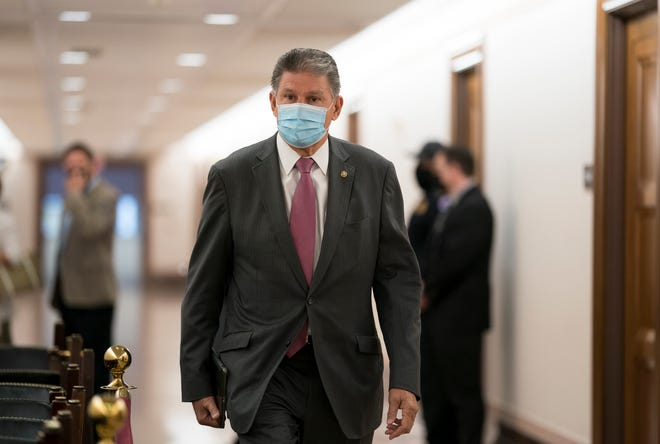 Sen. Joe Manchin, D-W.Va., heads to a Senate Energy and Natural Resources Committee hearing on Capitol Hill in Washington on April 21, 2021.