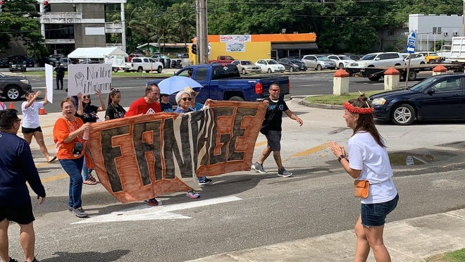 After a political status plebiscite was ruled ineligible, Guam residents rally for self-determination.