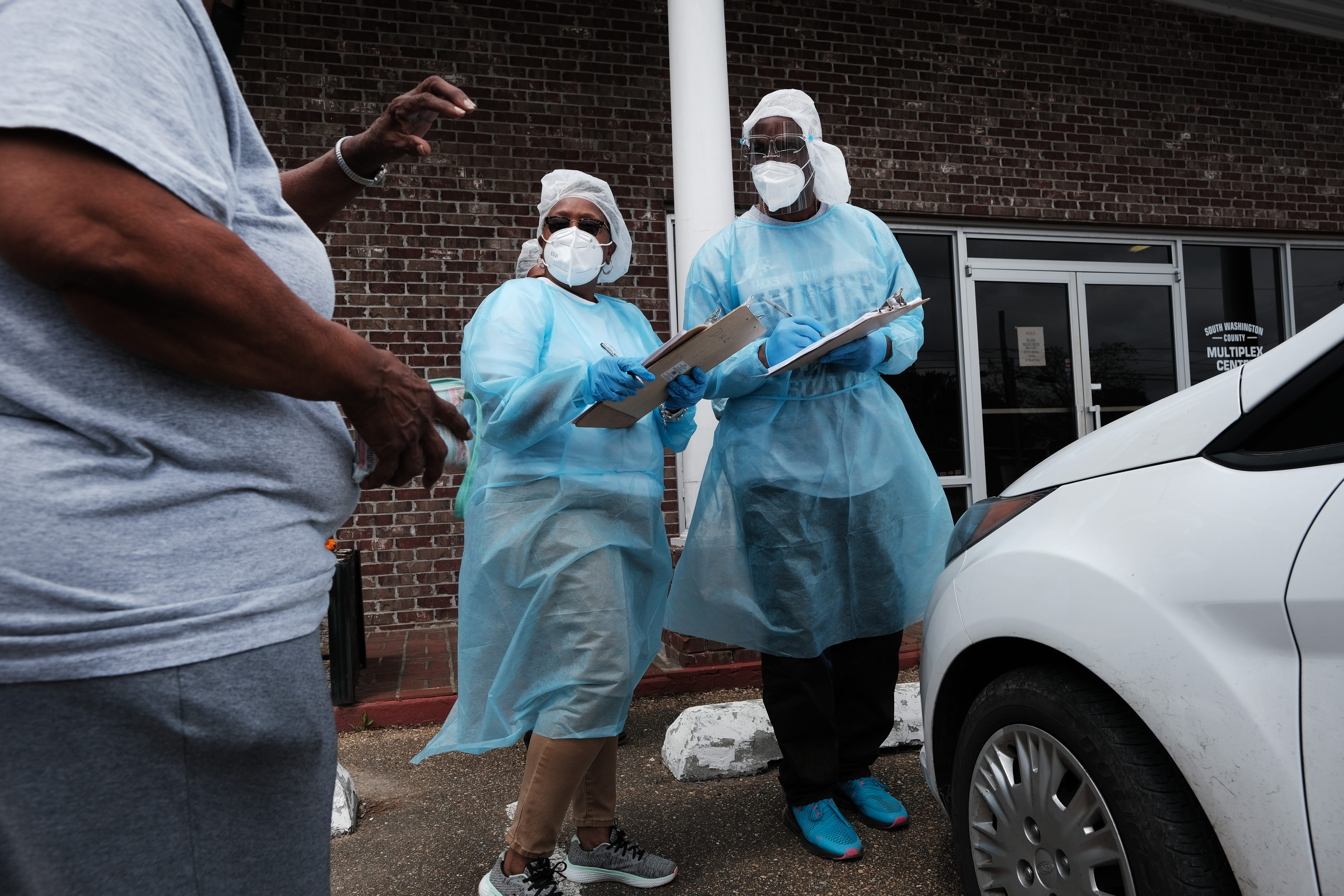 Medical workers with Delta Health Center wait to vaccinate people at a pop-up COVID-19 vaccination clinic April 27 in the rural community of Hollandale, Miss. Mississippi has been working to vaccinate residents in remote areas who may not have access to the internet or transportation.