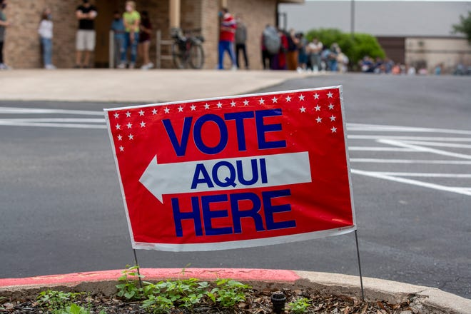 A voting sign can be seen outside a polling statin in Northwest Austin on Saturday, May 1, 2021.