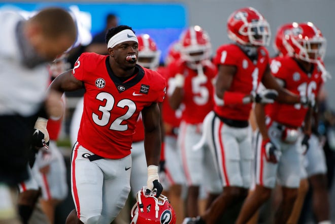 Oct 3, 2020; Athens, GA, USA; Georgia inside linebacker Monty Rice (32) leads the team onto the field for warm ups before the start of an NCAA college football game between Georgia and Auburn in Athens, Ga., on Saturday, Oct. 3, 2020. Joshua L. Jones-USA TODAY NETWORK