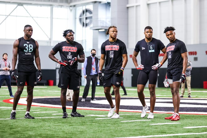 Georgia defensive back Mark Webb (23), Georgia defensive back Richard LeCounte (2), Georgia defensive back Eric Stokes (27), Georgia defensive back Tyson Campbell (3), Georgia defensive back DJ Daniel (14) during Georgia's 2021 NFL Pro Day inside the William Porter Payne and Porter Otis Payne Indoor Athletic Facility in Athens, Ga., on Wednesday, March 17, 2021. (Photo by Tony Walsh)