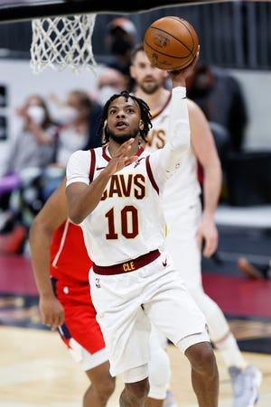 Cleveland Cavaliers' Darius Garland (10) puts up a shot against the Washington Wizards during the first half of an NBA basketball game, Friday, April 30, 2021, in Cleveland. (AP Photo/Ron Schwane)
