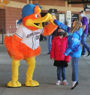 Akron RubberDucks mascot Webster gets a high-five from Miley Siers, 8, with her sister Ana, 7, of Akron, during an open house for season pass holders Saturday at Canal Park downtown.