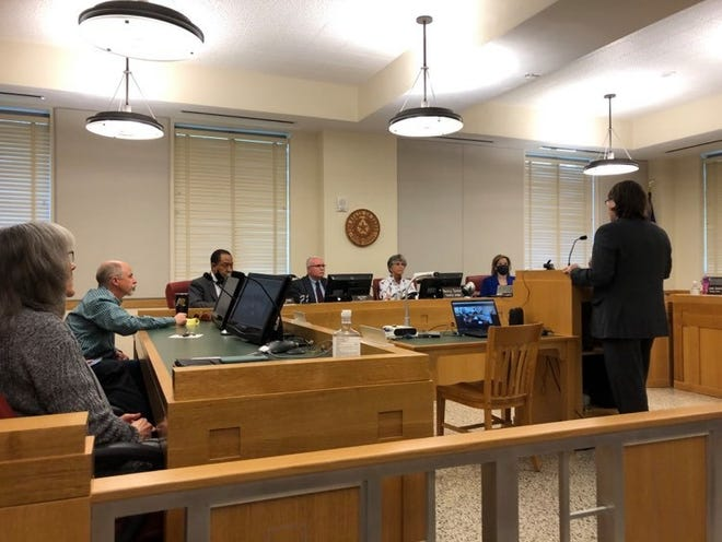 Members of the Potter County Commissioners' Court hear from Matt Knecht, a representative from the Neighborhood Defender Service, during Friday's special meeting of the court.