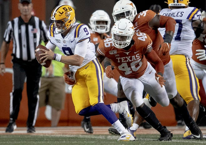 Texas linebacker Joseph Ossai (46) sacks LSU quarterback Joe Burrow (9) during an NCAA football game on Saturday, Sept. 7, 2019, in Austin, Texas. [NICK WAGNER/AMERICAN-STATESMAN]