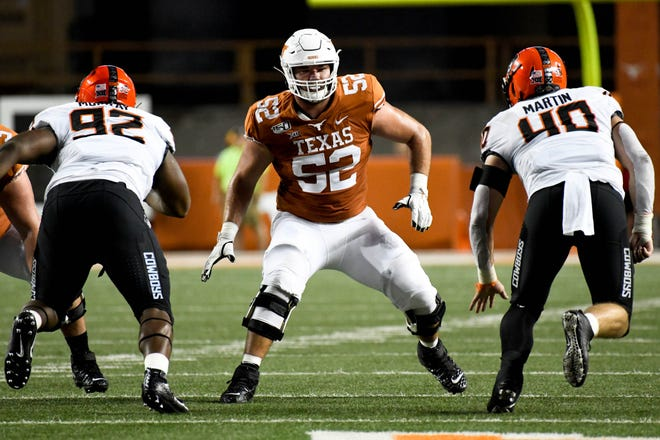 Texas offensive lineman Samuel Cosmi (52) became the first Longhorns offensive lineman drafted since Connor Williams went in the second round in 2018.