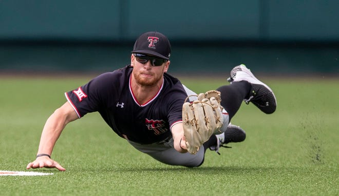Texas Tech center fielder Dillon Carter makes a diving catch on a line drive Friday, one of several big defensive plays he made in the win over the Longhorns.