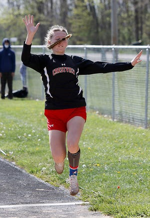Crestview's Emma Aumend competes in the long jump Friday at the Mapleton Track Invitational.