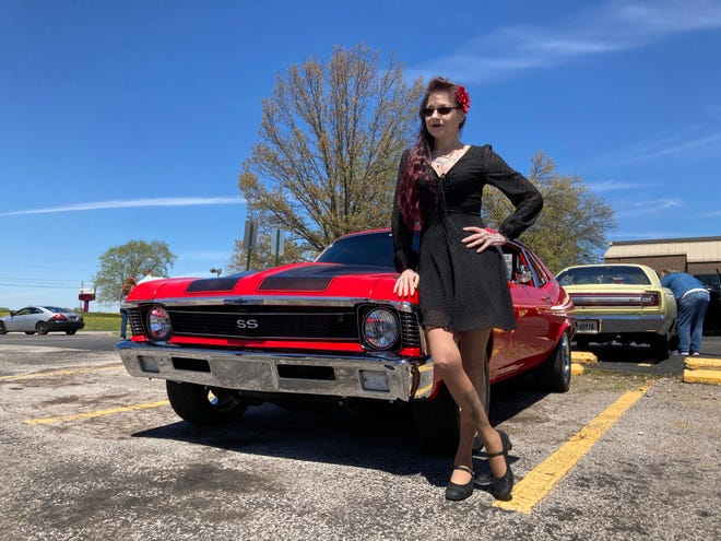Kandi McCrea stands beside her 1972 Chevy Nova at the Car Cruise at the Ashland County-West Holmes Career Center.