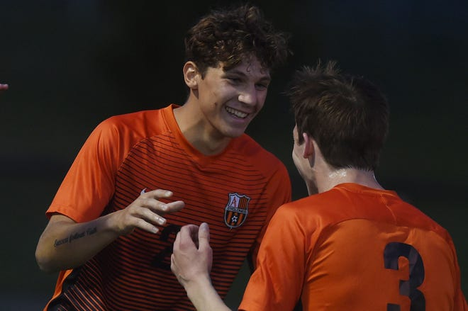 Ames' mid-fielder Jordan Corrieri celebrates with teammate Tate Downs after scoring a goal during the first half against Mason City Friday at the Ames High Football Field in Ames. Corrieri scored his second-hat trick of the season to lead Ames to a 6-0 victory.
