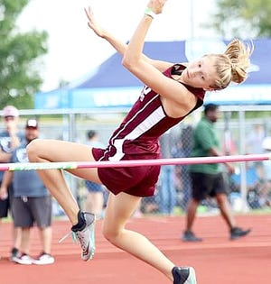 Merryville senior Maddie Mahfouz clears the high jump bar en route to winning the event with a height of 4-11. Mahfouz won four gold medals on Thursday in the regional meet at New Iberia.