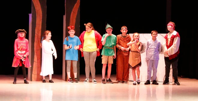 """The """"Pan!"""" cast of Early Elementary School fifth-graders is pictured on stage before beginning a rehearsal after school Friday afternoon."""