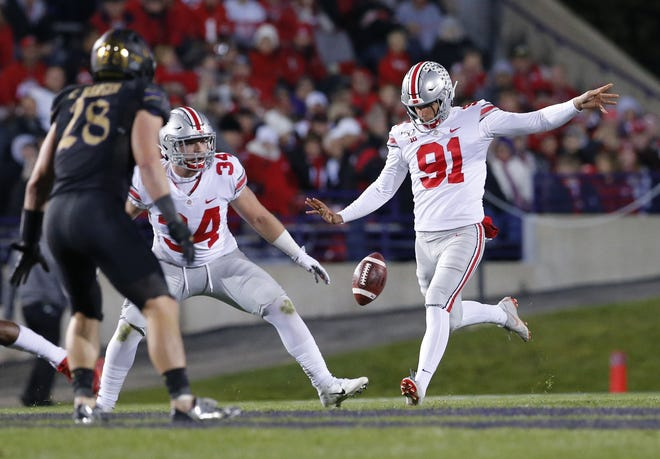 Ohio State Buckeyes punter Drue Chrisman (91) kicks a punt over running back Mitch Rossi (34) and Northwestern Wildcats linebacker Chris Bergin (28) during the NCAA football game at Ryan Field in Evanston, Ill. on Friday, Oct. 18, 2019. Ohio State won 52-3. [Adam Cairns/Dispatch]
