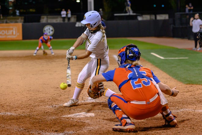 Missouri's Jenna Laird (3) connects for a hit during a game against Florida on Friday night at Mizzou Softball Stadium.