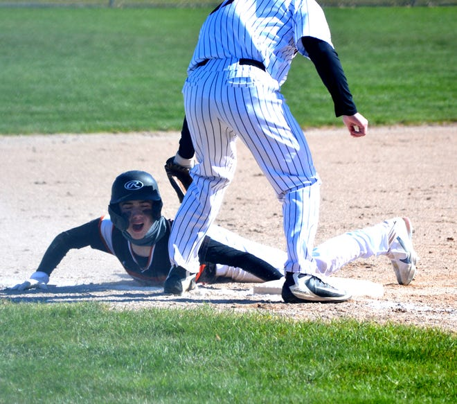 Cheboygan's Kaleb Blaskowski, left, slides into third base safely during game one of a Straits Area Conference baseball doubleheader against Rudyard in Cheboygan on Friday.