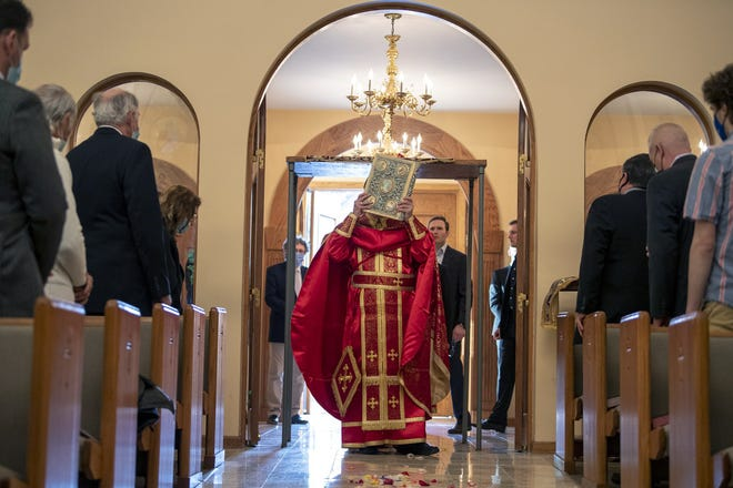 The Rev. Demetrios Gardikes during a Holy Friday service at Annunciation Greek Orthodox Cathedral on April 30.