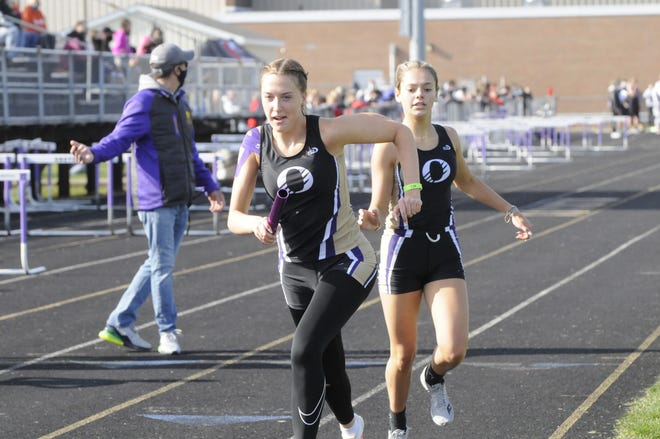 Onsted's Kamryn Ross runs after receiving the handoff from Kara Terakedis during the 4x800-meter relay at the Onsted Early Bird Invite earlier in the 2021 season.