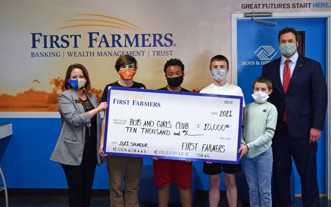 First Farmers and Merchants Bank donated $10,000 to the Boys & Girls Clubs of South Central Tennessee. From left, Boys & Girls Club CEO Robyn Peery, club members Michael King, James Stewart Jr. , Mason Hamilton, and AJ Register, stand with First Farmers club board member Sam Wantland.