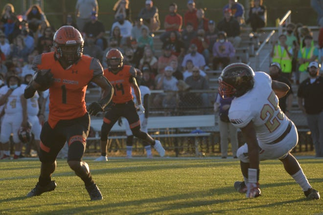 North Davidson's Jamarien Dalton starts to turn upfield on what became a 50-yard touchdown reception in Friday's 2-AA state semifinal game with Salisbury. The Black Knights fell 24-21. [Mike Duprez/The Dispatch]