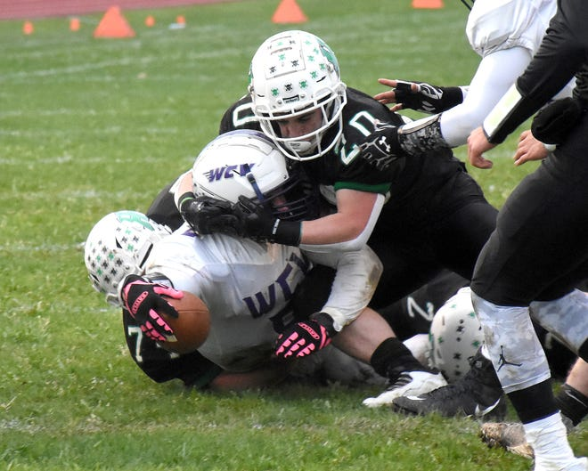 West Canada Valley Indian Michael Tubia Jr reaches for the goal line while being tackled by Herkimer Magicians Braden Alexander (20) and Aidan Ploss during the first quarter Friday.