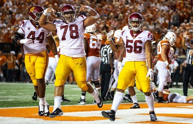 USC linebacker Jordan Iosefa (56) and defensive lineman Jay Tufele (78) celebrate a sack during an NCAA college football game against Texas in Austin, Texas, on Saturday, Sept. 15, 2018. NICK WAGNER / AMERICAN-STATESMAN